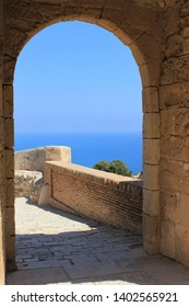 arch overlooking the sea and orange tree