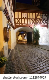 arch passage built in Bavarian style, night street with cobblestone, typical architecture of Bavaria land, small town of  Franconia - Kronach, Bavaria, Germany, Europe,  wallpaper vertical townscape