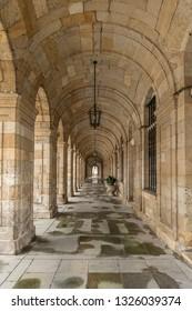 Arch pathway at the Palacio de Raxoi, Santiago de Compostela, Spain. Barrel vault architecture detail. Neoclasic building of century XVIII