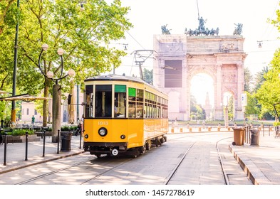 Arch of Peace (Arco della Pace) view with nostalgic yellow tram in Milano, Italy.