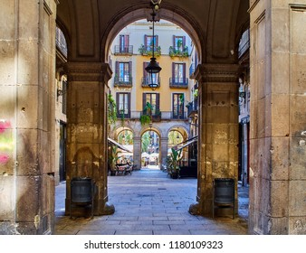 Arch pillar in the Barri Gòtic (Old Town) of Barcelona leading to Plaça Reial (Royal Square)