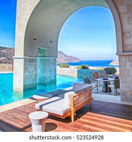 arch pool terrace on summer resort  with beautiful Mediterranean sea view, Greece. Square toned image