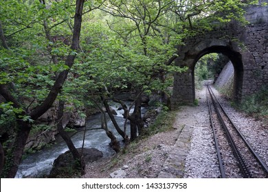Arch and river near railway in Vouraikos gorge
