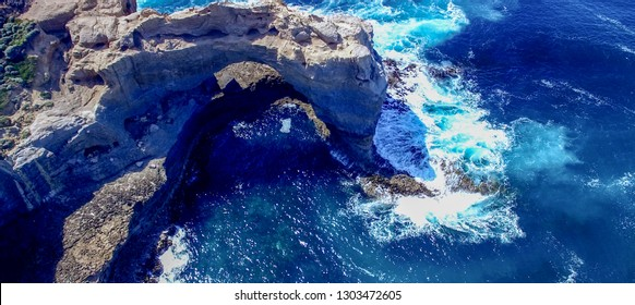 The Arch. Rock formation along Great Ocean Road, Australia. Aerial view.