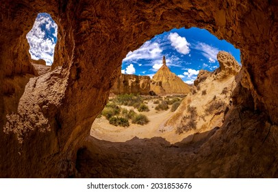 Arch in the sand rocks cave. Cave in sandstones. Cave hole in sandstone. View from sandstone cave