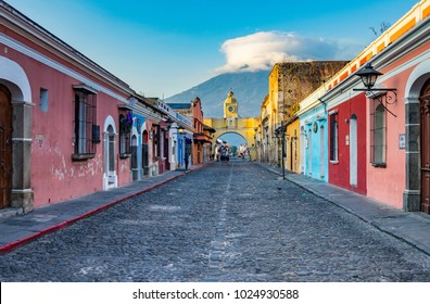 Arch Street of Antigua Guatemala featuring the Santa Catalina Arch and the Agua Volcano in the background.