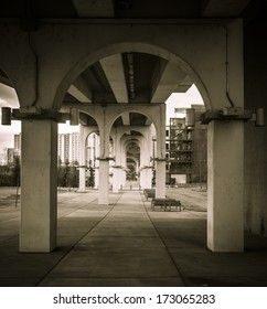 Arch supports under the walking bridge in Nashville, TN leading into the distance
