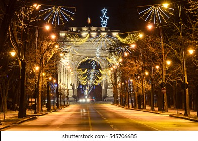 The Arch of Triumph (Arcul de Triumf) from Bucharest Romania, Christmas lights ornaments, view from Kisseleff Avenue.