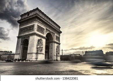 Arch of Triumph on Place de l'Etoile in Paris, France, at sunset