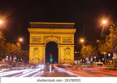 Arch of Triumph of the Star (Arc de Triomphe de l'Etoile) in Paris (France) at night