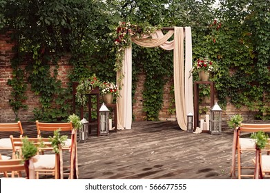 arch for the wedding ceremony, decorated cloth flowers greenery,
