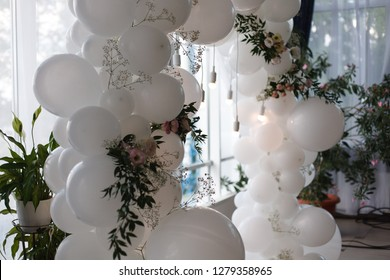 an arch of white balloons . festive decor for the wedding. decor of balloons and lights. wedding background