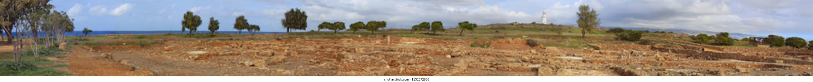 Archaeological park of Kato Paphos. Panorama of ancient ruins overlooking the lighthouse and the sea.