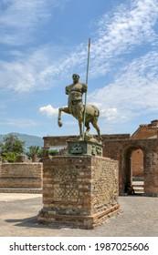 Archaeological Park of Pompeii. Mitoraj centaur statue in the forum. Campania, Italy