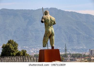 Archaeological Park of Pompeii. Sanctuary of Venus and the statue of Daedalus of Mitoraj. Campania, Italy