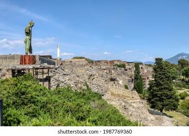 Archaeological Park of Pompeii. Sanctuary of Venus and the statue of Daedalus of Mitoraj. Campania, Italy. 02.06.2021