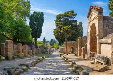 Archaeological ruin of ancient Roman city, Pompeii, was destroyed by Eruption of Vesuvius, volcano nearby city in Pompeii, Campania region, Italy. Stone street inside ruin of Pompeii roman city, Italy