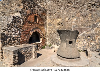 Archaeological ruin of ancient Roman city, Pompeii, was destroyed by Eruption of Vesuvius, volcano nearby city in Pompeii, Campania region, Italy.  Ancient stone oven in historical site of Pompeii.