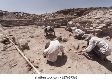 Archaeologist working in field, with special tools - Shutterstock ID 627689366