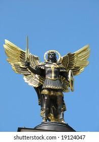 Archangel michael statue from bronze gilded in kiev, ukraine
