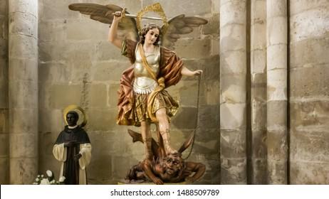the archangel Saint Michael killing the demon