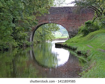An arched bridge on the Grand Union Canal at Lapworth in Warwickshire, England
