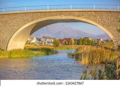 Arched bridge over Oquirrh Lake in Daybreak Utah