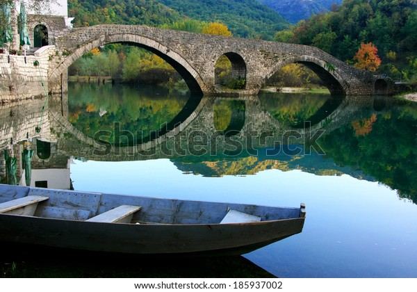 Arched bridge reflected in Crnojevica river, Montenegro, Balkans
