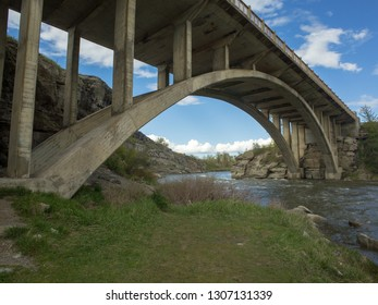 Arched Concrete Bridge Over a Rushing River, Alberta, Canada