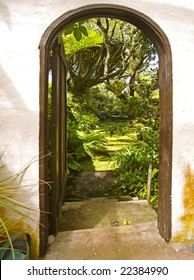 an arched doorway to a tropical garden in hawaii