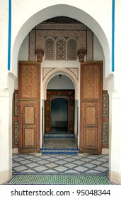 Arched entrance to the Bahia palace in Marrakech, with open ornamented door, Morocco