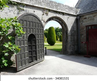 Arched gate and doorway at Lanhydrock Castle near Bodmin in Cornwall, England