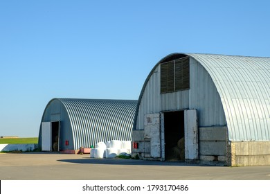 Arched hangars, Large storage for agricultural crops. Farm buildings.