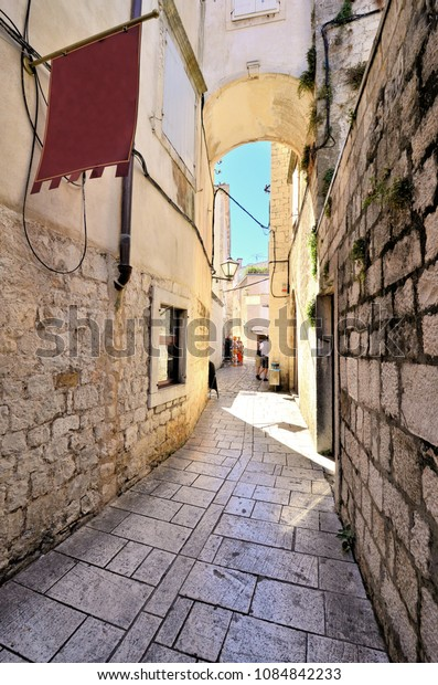 Arched medieval street in the old town of Trogir, Croatia