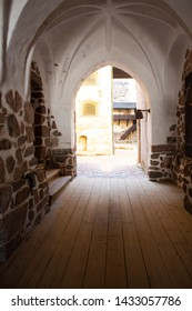 An arched opening leads to the second, small, inner, authentic courtyard of the medieval historical Abo castle in the city of Turku in Finland on a sunny summer day.