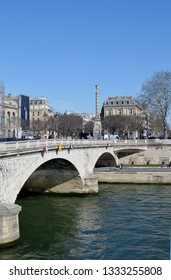 The arched Pont au Change bridge with the fountain, Fontaine du Palmier, completed in 1808. The bridge s where Javert throws himself into the river in Les Miserables.