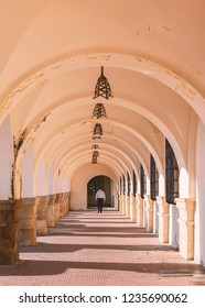 Arched portico walkway in Rhodes town, Greece.