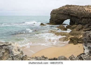 Arched rock formation on a coastal beach, near the light house at Robe, situated within the South East coastal region of South Australia,