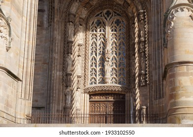 Arched stained glass window, adorned with Flamboyant Gothic, finely worked stone tracery, above the entrance door of the 15th century portal of Sainte-Cécile's Cathedral, in Albi, Southern France