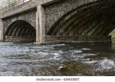 Arched Stone Bridge across wide stream