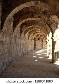 Arched stone gallery of light brown cloro, play of light and shade. Taken at the Aspendos Theater (right on top) in Turkey.