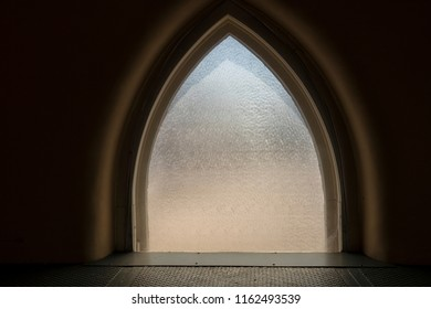 Arched window with structured glass as a background