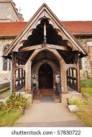 Arched Wooden Entrance to a medieval English Village Church