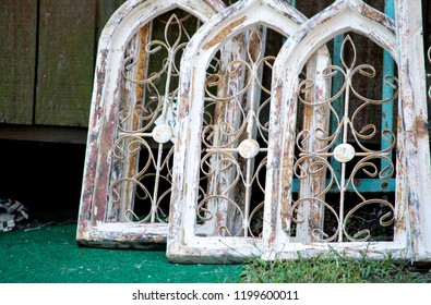 arched wooden windows at a salvage yard
