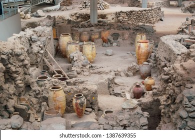 Archeological site discovered after excavation  with urns and other utensils for display