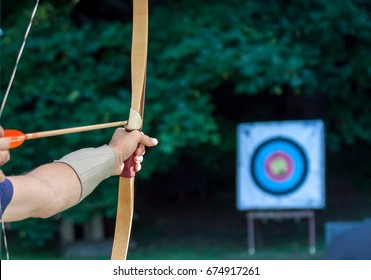 archer aiming arrow at sport aim