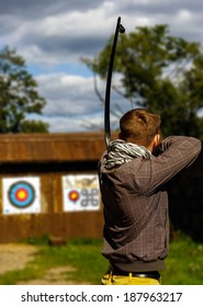 Archer aiming at the target, focused and concentrated  Objectives / Goals / Success / Aim / Target / Archery / Business / Challenge Background