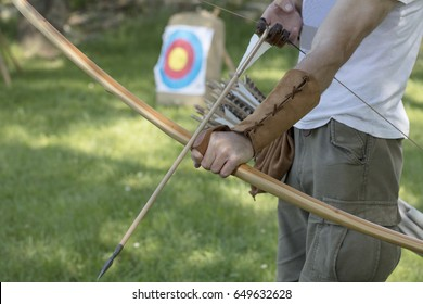 Archer with medieval English longbow and arrows. Sport and recreation concept.