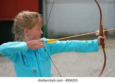 Archer taking aim to hit the bull's eye