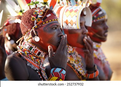 ARCHERS POST - KENYA - JANUARY 14, 2015: Unidentified Samburu warriors singing at a wedding ceremony on January 14, 2015 in Archers Post, Kenya.